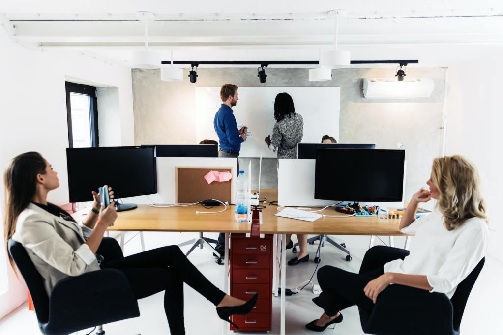 Business people sitting in office and learning new technologies