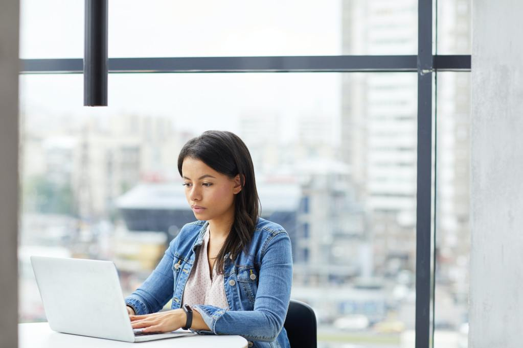Businesswoman typing on laptop at office