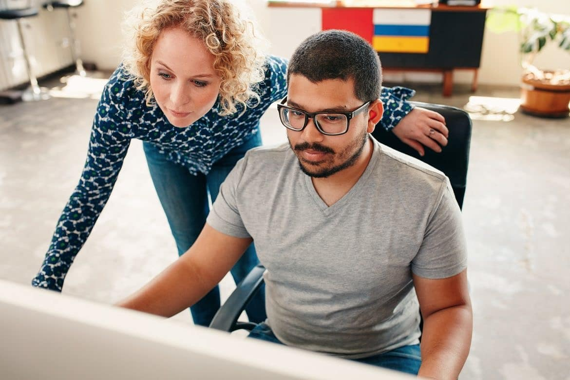 Graphic designers working on computer in office