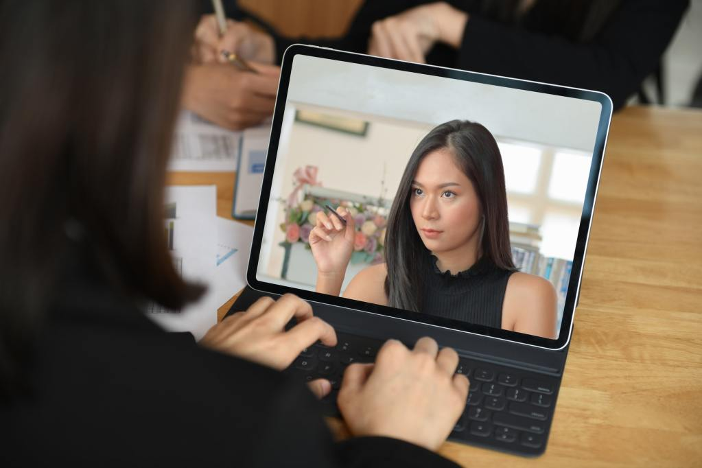 Female executive blamed staff on laptop screen while video conference.