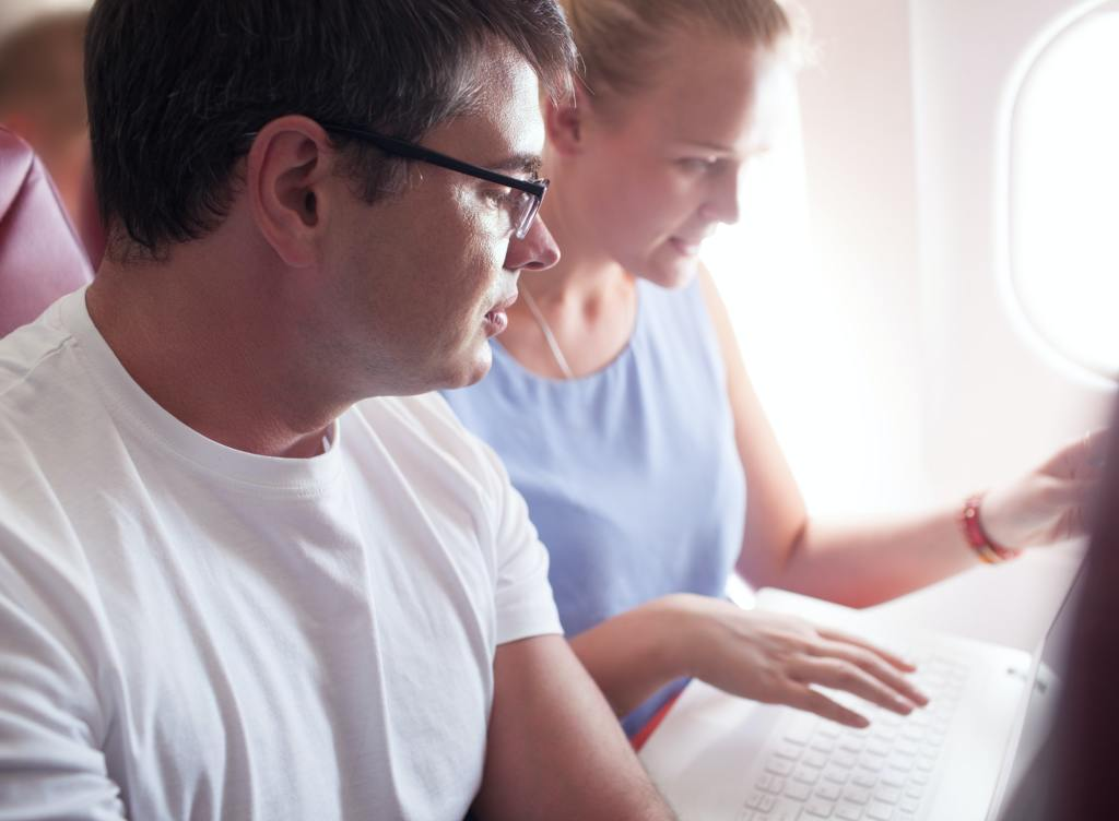 People with Laptop on a Plane