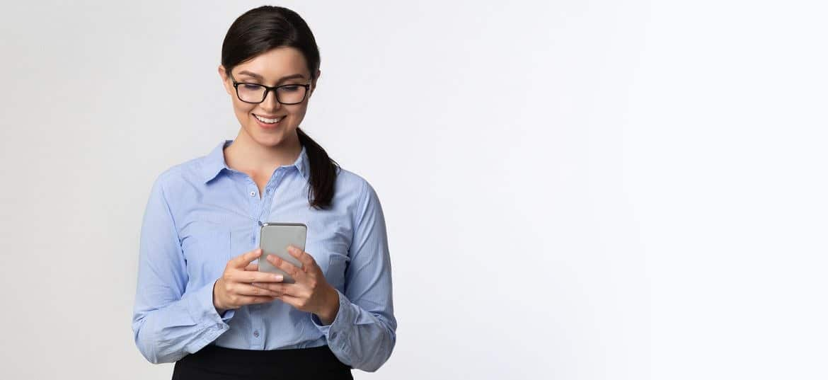 Business Girl Browsing On Smartphone Standing Over White Background