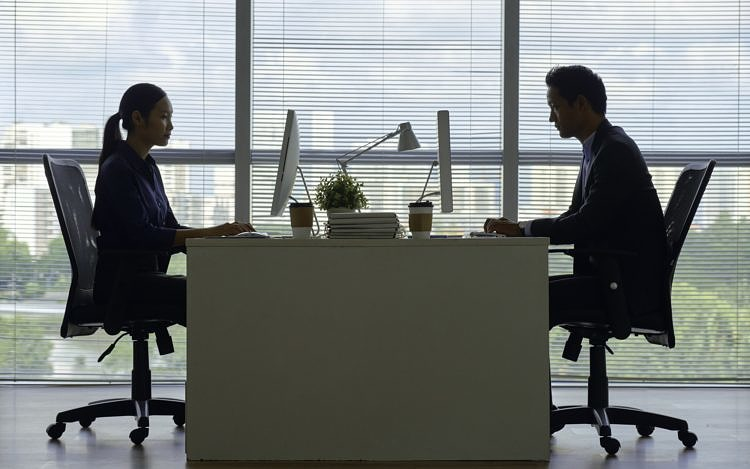 Business people working on computers in office